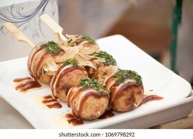 Takoyaki balls dumpling japanese food.aian street market takoyaki most popular delicious snack of japan