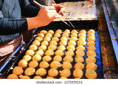 Takoyaki, the famous Street food in Dontonbori, Osaka, Japan.