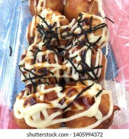 Takoyaki japanese food in plastic box, octopus balls.