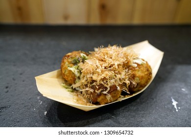 Takoyaki - Japanese octopus balls topped with takoyaki sauce, mayonnaise and dried bonito flakes, made of a wheat flour-based batter.