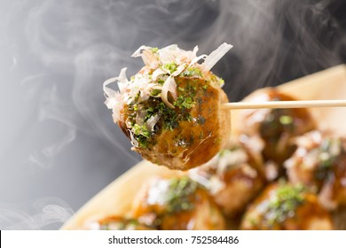 takoyaki, octopus balls, japanese food, on a black background