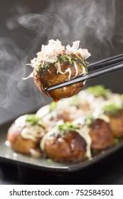 takoyaki, octopus balls, japanese food, on a black background