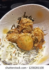 Takoyaki(ball-shaped Japanese snack made of a wheat flour and octopus)