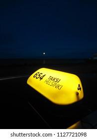 Taksi Helsinki Sign by night
