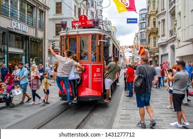 Taksim   Istanbul, TurkeyJune 15, 2019: Nostalgic Red Tram in Taksrilim Istiklal Street at evening. Taksim Istiklal Street is a popular destination in Istanbul. Beyoglu, Taksim, Istanbul. Turkey.