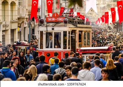 Taksim Istiklal street is always a crowded, busy, vibrant street. The historical tram line crosses the street,Beyoglu,Taksim,Istanbul,Turkey,October 2014