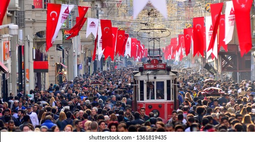 Taksim Istiklal street is always a crowded, busy, vibrant street. The historical tram line crosses the street, Beyoglu, Taksim,Istanbul,Turkey /26 October  2014