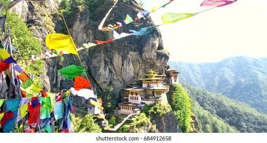 Taktshang Goemba or Tiger's nest monastery with colorful Tibetan prayer flags, Paro, Bhutan.