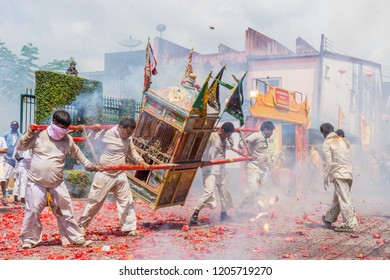 TAKUA PA, PHANG NGA/THAILAND - OCT 14, 2018: Local people and tourists celebrate a vegetarian festival in Takua Pa. This annual festival takes place from Oct 9 to Oct 17, 2018.