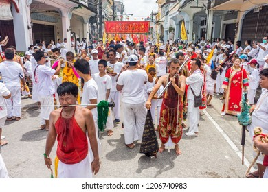 TAKUA PA, PHANG NGA/THAILAND - OCT 14, 2018: Masong Parades walk from an ahm to Takua Pa town in a vegetarian festival. This annual festival takes place from Oct 9 to Oct 17, 2018.