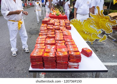 TAKUA PA, PHANG NGA/THAILAND - OCT 14, 2018: Chinese firecracker rolls in a vegetarian festival. This annual festival takes place from Oct 9 to Oct 17, 2018.