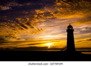 Talacre Lighthouse against a dramatic sunset