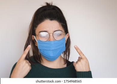Talagante, Santiago / Chile - June 4 2020: woman using face mask and foggy eyewear.