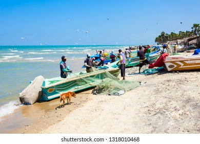 TALAIMANNAR, SRI LANKA - FEBRUARY 12, 2017: Fishermans at the Talaimannar beach. Talaimannar is located on the Mannar Island and about 18 miles from Dhanushkodi indian town.