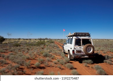 The Talawana Track, Western Australia - August 12, 2010: A 4WD off road vehicle is stopped on the remote Talawana Track in the Gibson Desert in outback Western Australia.