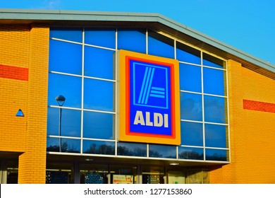 Talbot Green, County Borough of Rhondda Cynon Taf / Wales UK -12/7/2017: The logo and store sign of the Aldi supermarket in Talbot Green. Warm brickwork and blue sky.