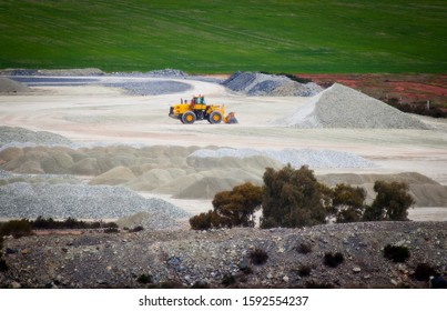 Talc mine in Western Australia. Bulldozer makes a pile of hydrated magnesium silicate.