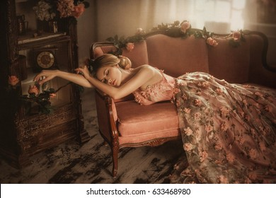 Tale of Sleeping Beauty. The girl is in the old, abandoned room. It covered the dust and roses. Summer atmosphere of sadness. Creative colors