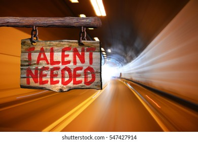 Talent needed motivational phrase sign on old wood with blurred background