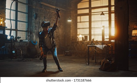 Talented Female Artist Wearing Virtual Reality Headset and Holding Digital Joysticks. She's Working on a Painting or Sculpture, Uses Motion Controllers To Create Concept Art. Creative Modern Studio.