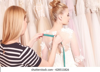Talented female tailor is making bridal clothing