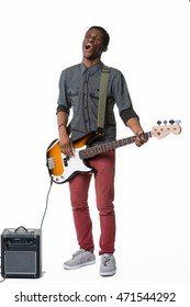 A talented person is talented in everything. Handsome man is singing and playing the electric guitar at the same time. Special small black amp for better sound.