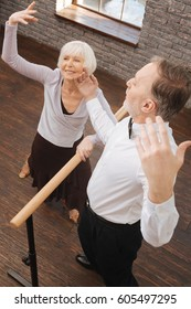 Talented retired dance couple acting in the art studio