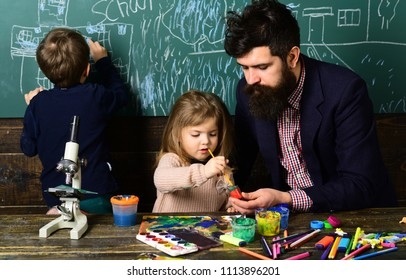 Talented schoolkid is doing his art homework in classroom at school. Kids really need is teacher who can meet them at home. tutor must be an energetic person.