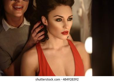 Talented stylist designing hairdo for model