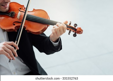 Talented violinist and classical music player solo performance, blank copy space on the right