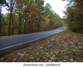 TALIMENA, OKLAHOMA—OCTOBER 2017: Roadside view with beautiful colors of fall at the Talimena National Scenic Byway in Oklahoma,with cars on the road.
