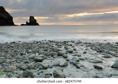 Talisker Bay, Minginsh, Isle of Skye, Scotland at Sunset with South Uist in the distance