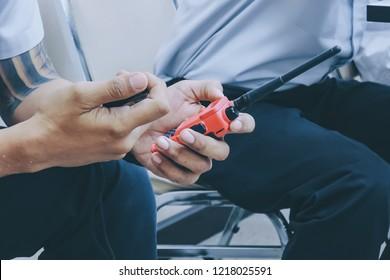 talkie walkie in hand of a man