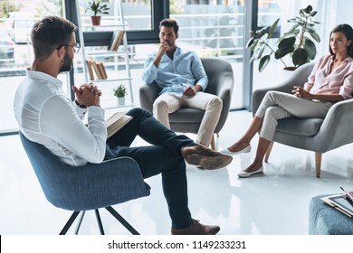 Talking is the best therapy. Young married couple talking while sitting on the therapy session with psychologist