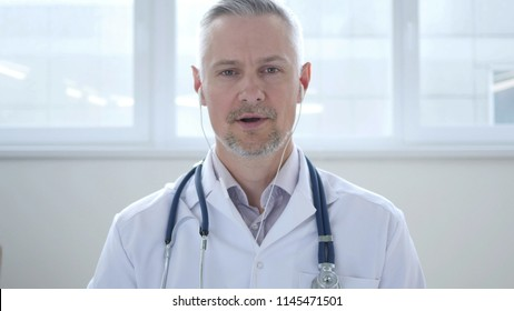 Talking Doctor During Online Video Chat with Patient