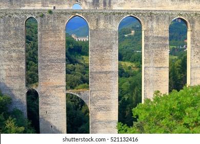 Tall arches of a medieval aqueduct (Ponte delle Torri) in Spoleto, Umbria, Italy