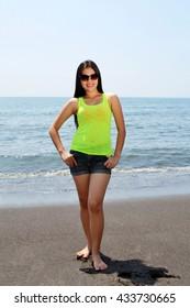 Tall Asian beauty posing on the beach in a tropical island