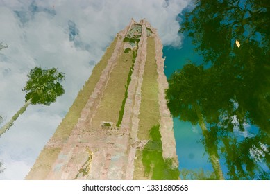 Tall, beautiful tower in Bok Tower Gardens in Lake Wales, Florida, USA, reflecting in the water below the building