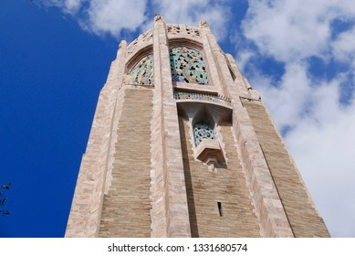 Tall, beautiful tower in Bok Tower Gardens in Lake Wales, Florida, USA; detail of designs at the top