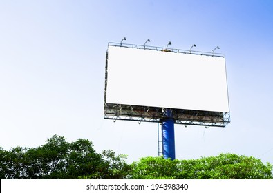 Tall billboards for advertising with blue sky.