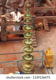 Tall brass deepam at Vindyagiri temple, Shravanabelagola, Hassan district, Karnataka State, India - 14th May 2018 : This 57 ft is one of the largest free monolithic standing statues in the world.