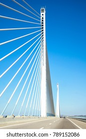 Tall Bridge on Highway with blue sky