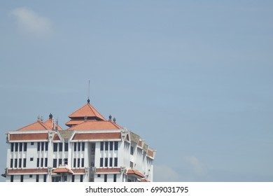 A tall building across the blue sky view from the highest senior high school building floors in Jakarta