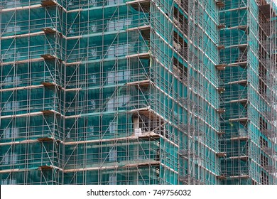 Tall building under construction with scaffolds
