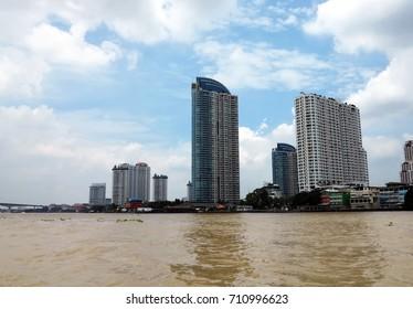 tall buildings with blue sky background,landscape along Chao Phraya riverside,Bangkok,Thailand