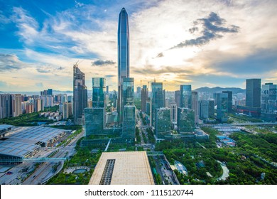 Tall buildings and traffic roads in downtown shenzhen at night.