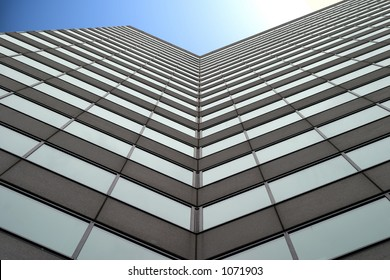 Tall business building with blue sky