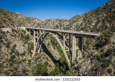 Tall cement bridge over a canyon in the San Gabriel Mountains of Angeles National Forest.