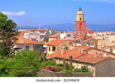 Tall church rising above the old town of Saint Tropez, French Riviera, France