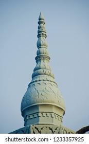 A tall concrete structure of a mosque building unique photo